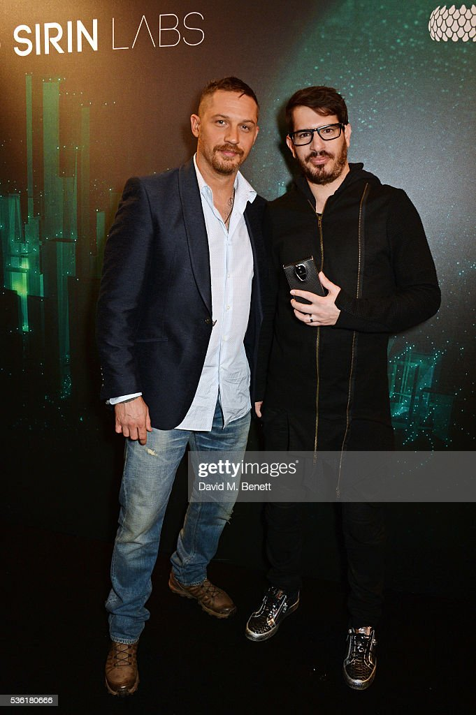 Tom Hardy (L) and Moshe Hogeg attend as SIRIN LABS Launches SOLARIN at One Marylebone on May 31, 2016 in London, England.