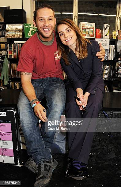 Tom Hardy and Noomi Rapace attend the Blag Magazine 20th anniversary special edition signing at Rough Trade East on November 17 2012 in London England