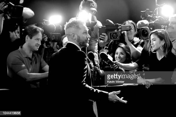 """Tom Hardy arrives at the premiere of Columbia Pictures' """"Venom"""" at the Village Theatre on October 1, 2018 in Los Angeles, California."""