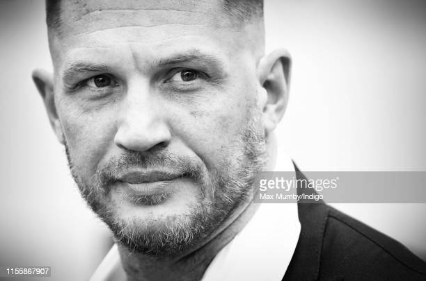 Tom Hardy attends the Sentebale Audi Concert at Hampton Court Palace on June 11 2019 in London England The charity Sentebale was founded by Their...
