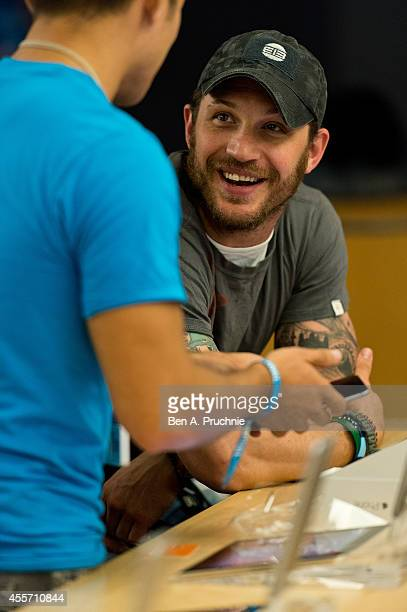 Tom Hardy gets set up with the new iPhone 6 at The Apple Store Regent Street on September 19 2014 in London England