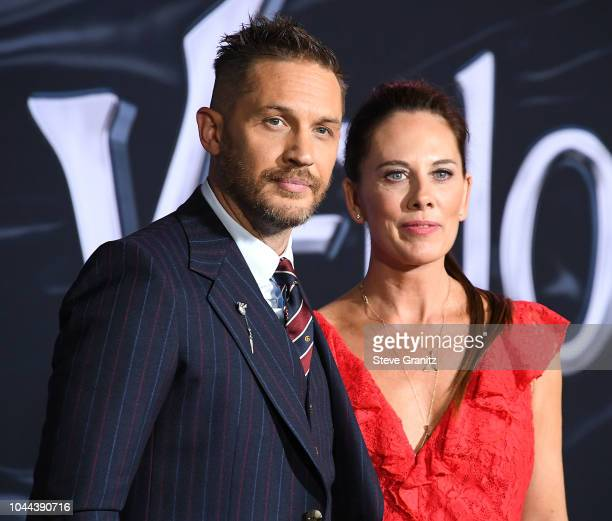 """Tom Hardy, Kelly Marcel arrives at the Premiere Of Columbia Pictures' """"Venom"""" at Regency Village Theatre on October 1, 2018 in Westwood, California."""