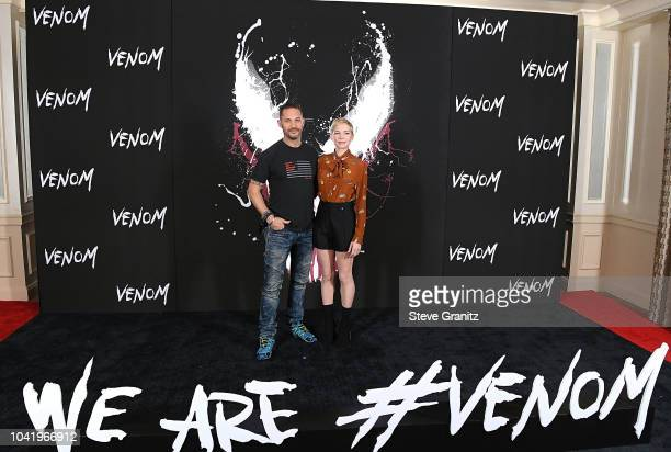 """Tom Hardy, Michelle Williams poses at the Photo Call For Columbia Pictures' """"Venom"""" at Four Seasons Hotel Los Angeles at Beverly Hills on September..."""