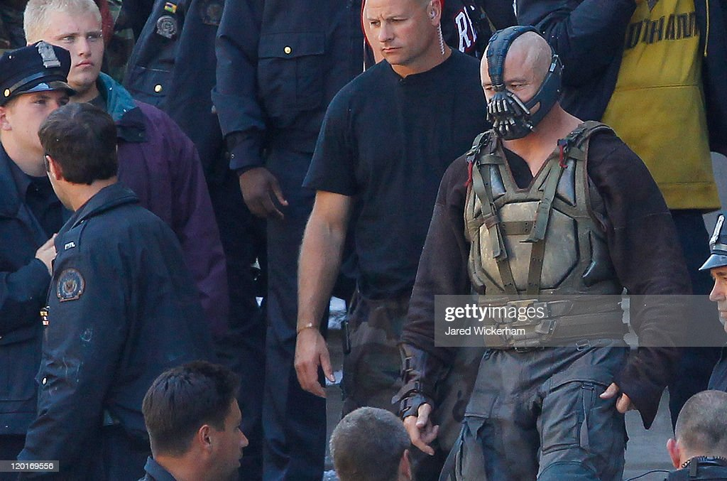 Tom Hardy, playing Bane, walks around in between scenes during the filming of the new Batman: Dark Knight Rises movie at the Mellon Institute building in the Oakland neighborhood of Pittsburgh, PA on July 31, 2011.