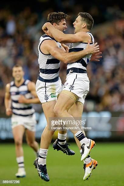 Tom Hawkins and 200 game player Harry Taylor of the Cats celebrate a goal during the round 21 AFL match between the Richmond Tigers and the Geelong...