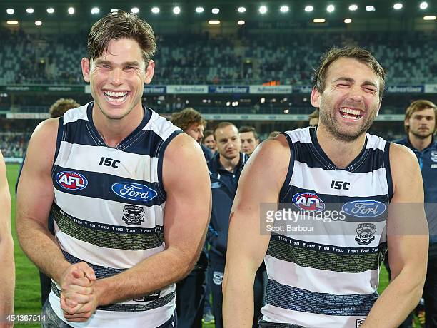 Tom Hawkins and Corey Enright of the Cats laugh as they leave the field after winning the round 23 AFL match between the Geelong Cats and the...