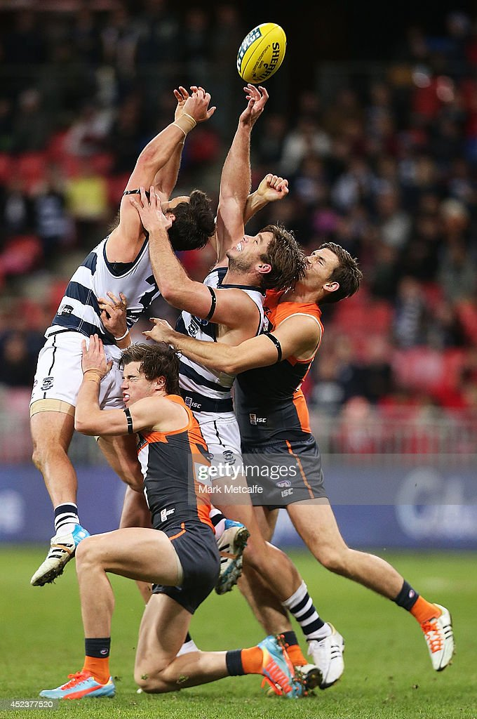Tom Hawkins and Jimmy Bartel of the Cats compete for the ball against Phil Davis and Lachlan Plowman of the Giants during the round 18 AFL match between the Greater Western Sydney Giants and the Geelong Cats at Spotless Stadium on July 19, 2014 in Sydney, Australia.