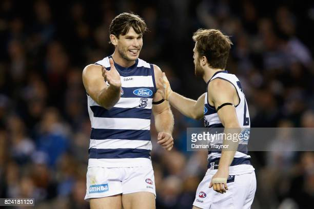 Tom Hawkins and Jordan Murdoch of the Cats celebrates a goal during the round 19 AFL match between the Carlton Blues and the Geelong Cats at Etihad...