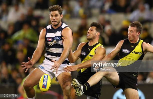 Tom Hawkins of the Cats and Alex Rance of the Tigers and Dylan Grimes of the Tigers compete for the ball during the round 20 AFL match between the...