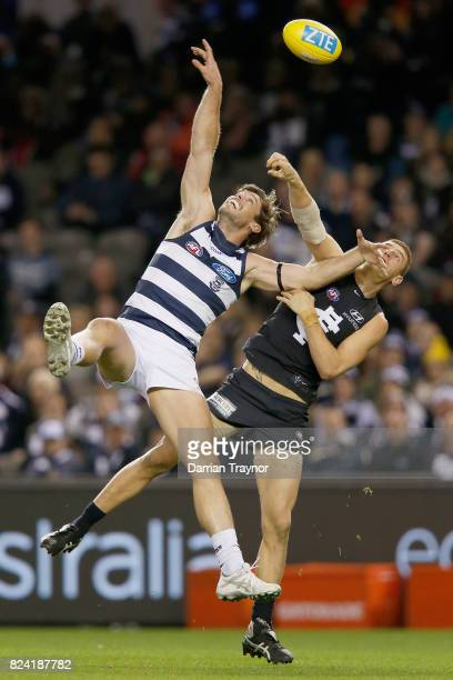 Tom Hawkins of the Cats and Liam Jones of the Blues compete during the round 19 AFL match between the Carlton Blues and the Geelong Cats at Etihad...