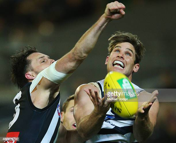 Tom Hawkins of the Cats and Nathan Brown of the Magpies compete for the ball during the round 22 AFL match between the Geelong Cats and the...