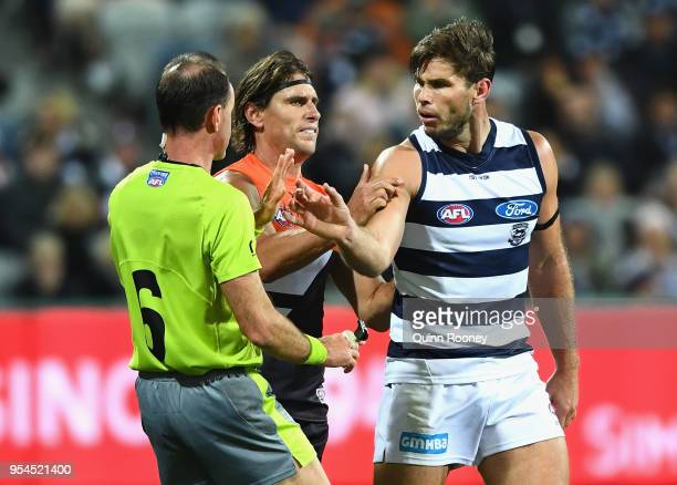 Tom Hawkins of the Cats argues with the umpire after an incident with Nick Haynes of the Giants during the round seven AFL match between the Geelong...