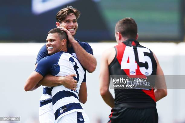 Tom Hawkins of the Cats celebrates a goal with Brandon Parfitt of the Cats during the JLT Community Series AFL match between the Geelong Cats and the...
