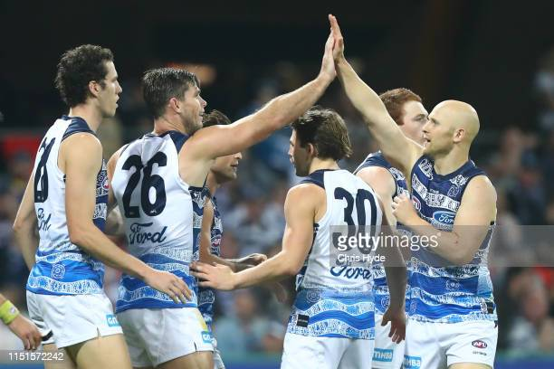Tom Hawkins of the Cats celebrates a goal with Gary Ablett during the round 10 AFL match between the Gold Coast Suns and the Geelong Cats at Metricon...
