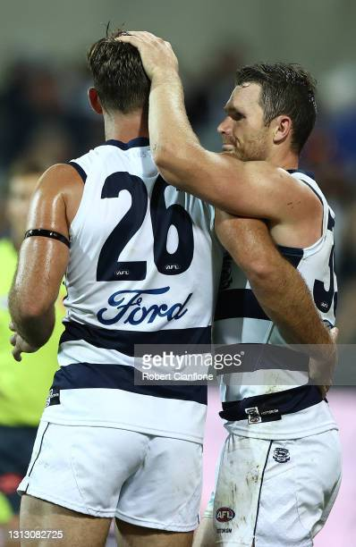 Tom Hawkins of the Cats celebrates after scoring a goal with Patrick Dangerfield during the round five AFL match between the Geelong Cats and the...
