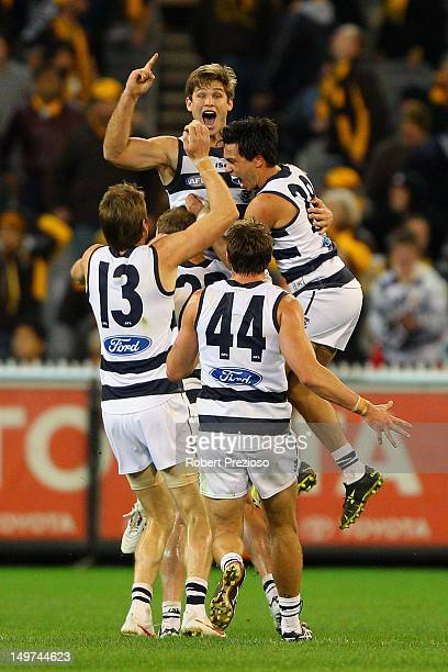 Tom Hawkins of the Cats celebrates kicking a goal with teammates to win the game during the round 19 AFL match between the Hawthorn Hawks and the...