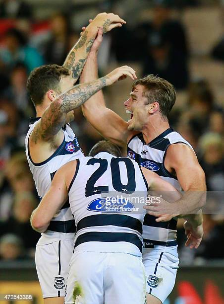 Tom Hawkins of the Cats celebrates with Steve Johnson and Mitch Clark after kicking a goal during the round six AFL match between the Collingwood...
