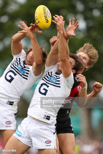 Tom Hawkins of the Cats contests the ball in the air during the JLT Community Series AFL match between the Geelong Cats and the Essendon Bombers at...