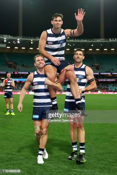 Tom Hawkins of the Cats is chaired off after playing his 250th match, winning the round 19 AFL match between the Sydney Swans and the Geelong Cats at...