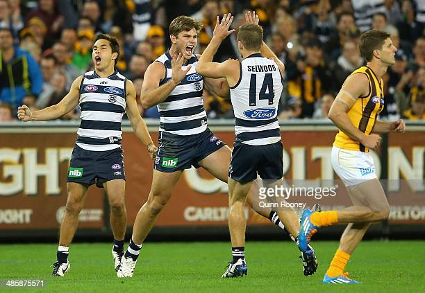 Tom Hawkins of the Cats is congratulated by Joel Selwood oand Mathew Stokes after kicking a goal during the round five AFL match between the Geelong...