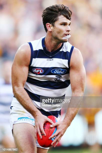 Tom Hawkins of the Cats looks upfield with his mouthguard hanging out during the round 21 AFL match between the Hawthorn Hawks and the Geelong Cats...