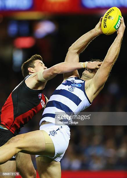 Tom Hawkins of the Cats marks the ball against Michael Hartley of the Bombers during the round 20 AFL match between the Geelong Cats and the Essendon...
