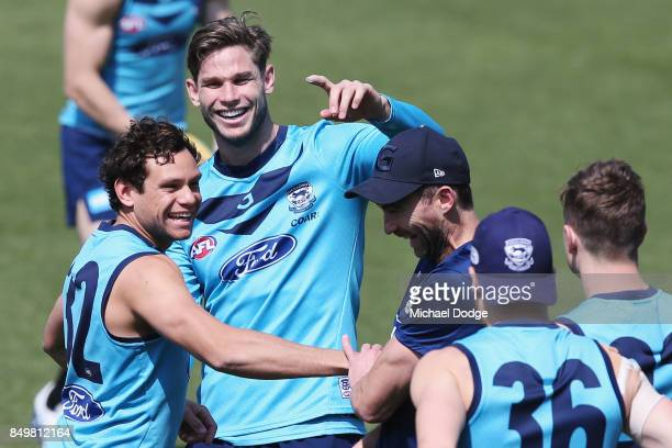 Tom Hawkins of the Cats reacts with Steven Motlop of the Cats during the Geelong Cats AFL training session at Simonds Stadium on September 20 2017 in...