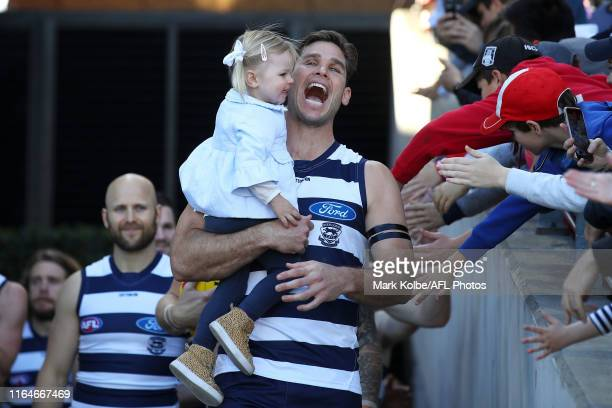 Tom Hawkins of the Cats shares a laugh with his daughter Arabella as he leads the Cats out before playing his 250th game during the round 19 AFL...