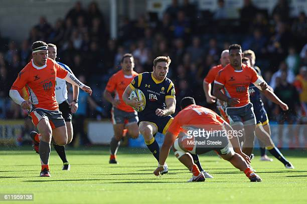 Tom Heahtcote of Worcester runs at Sinoti Sinoti of Newcastle during the Aviva Premiership match between Worcester Warriors and Newcastle Falcons at...