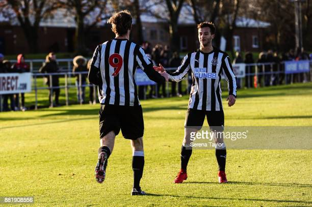 Tom Heardman of Newcastle celebrates with Jamie Sterry after he scores Newcastle's third goal during the Premier League 2 match between Newcastle...