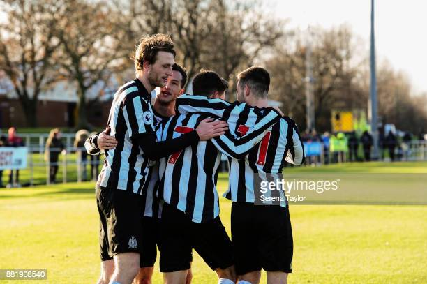Tom Heardman of Newcastle celebrates with teammates Jamie Sterry and Victor Fernandez and Callum Roberts after he scores Newcastle's Fourth goal and...