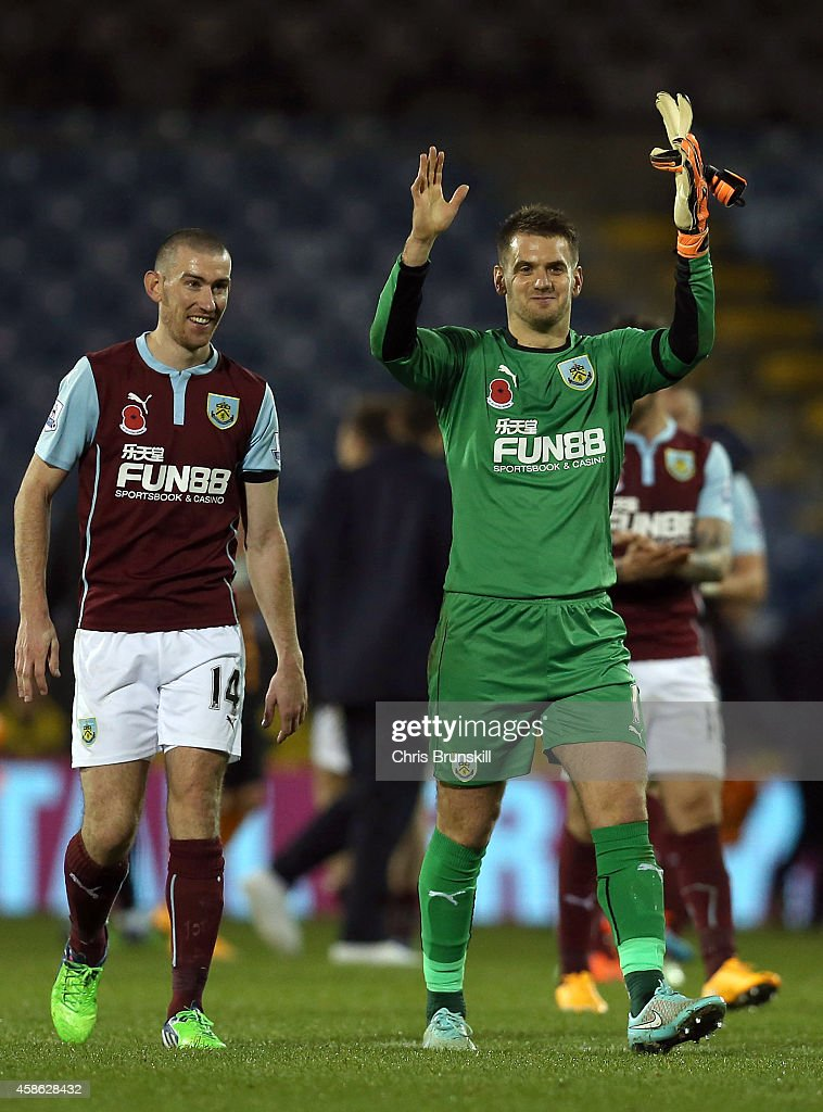Tom Heaton and David Jones (L) of Burnley celebrate at full-time following the Barclays Premier League match between Burnley and Hull City at Turf Moor on November 08, 2014 in Burnley, England.