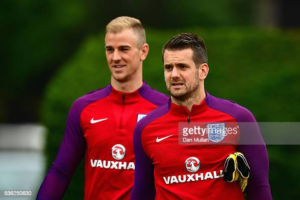 Tom Heaton and Joe Hart of England look on during an England training session at London Colney on June 1 2016 in St Albans England