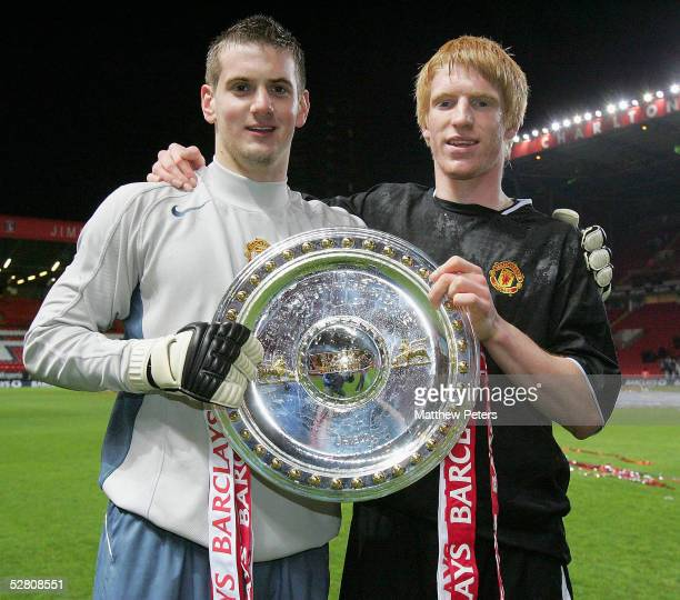 Tom Heaton and Paul McShane of Manchester United pose with the trophy after winning the Barclays FA Premier Reserve League Shield playoff final match...