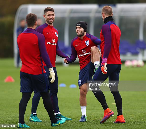 Tom Heaton Gary Cahill Jack Wilshere and Joe Hart in discussion during an England training session on the eve of their international friendly match...