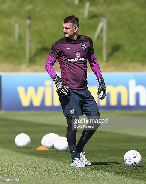 Tom Heaton looks on during the England training session held at St Georges Park on June 4 2015 in BurtonuponTrent England