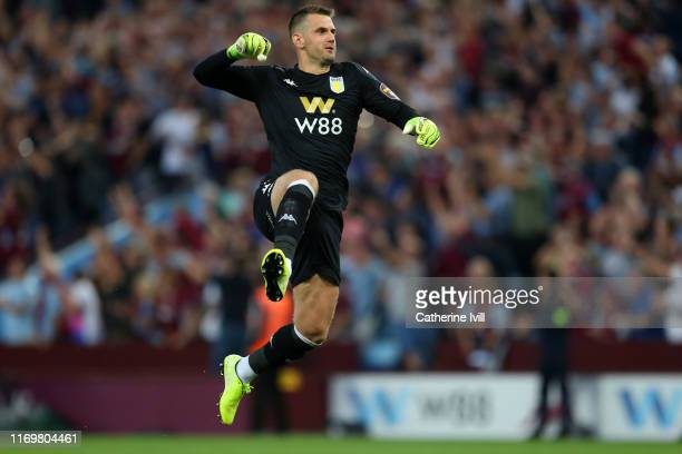 Tom Heaton of Aston Villa celebrates after his team mate Wesley scored their teams first goal during the Premier League match between Aston Villa and...