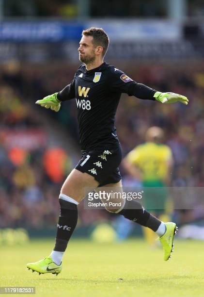 Tom Heaton of Aston Villa celebrates his teams third goal during the Premier League match between Norwich City and Aston Villa at Carrow Road on...