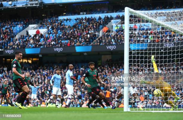 Tom Heaton of Aston Villa fails to save as Kevin De Bruyne of Manchester City scores his team's second goal during the Premier League match between...