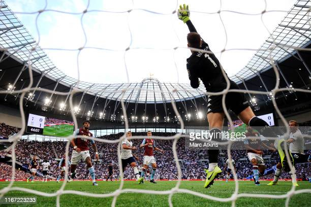 Tom Heaton of Aston Villa jumps to save the ball from Harry Kane of Tottenham Hotspur during the Premier League match between Tottenham Hotspur and...