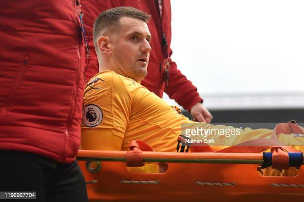 Tom Heaton of Aston Villa leaves the pitch on a stretcher after being injured during the Premier League match between Burnley FC and Aston Villa at...