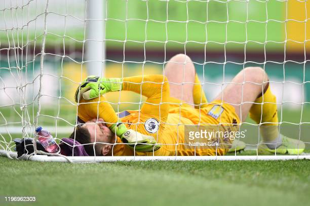 Tom Heaton of Aston Villa reacts with an injury during the Premier League match between Burnley FC and Aston Villa at Turf Moor on January 01 2020 in...