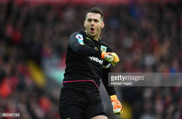 Tom Heaton of Burnley celebrates his sides first goal after Ashley Barnes of Burnley scored during the Premier League match between Liverpool and...