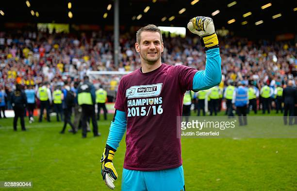Tom Heaton of Burnley celebrates winning the Championship after the Sky Bet Championship between Charlton Athletic and Burnley at the Valley on May 7...