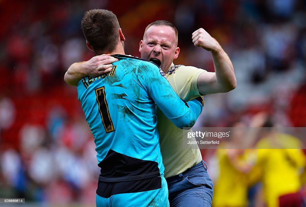 Tom Heaton of Burnley celebrates with a fan who ran on the pitch at the final whistle during the Sky Bet Championship between Charlton Athletic and Burnley at the Valley on May 7, 2016 in London, United Kingdom.
