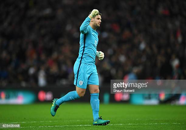 Tom Heaton of England celebrates his teams second goal of the game during the international friendly match between England and Spain at Wembley...