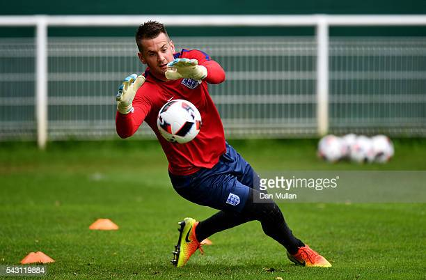 Tom Heaton of England makes a save during a training session ahead of the UEFA Euro 2016 match against Iceland at Stade du Bourgognes on June 26 2016...