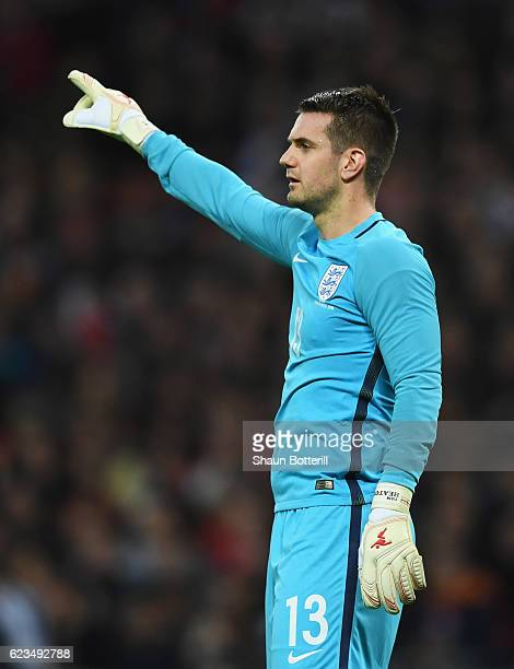 Tom Heaton of England organises his defence during the international friendly match between England and Spain at Wembley Stadium on November 15 2016...