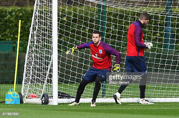 Tom Heaton of England warms up with Fraser Forster during a training session prior to the International Friendly match against the Netherlands at the...
