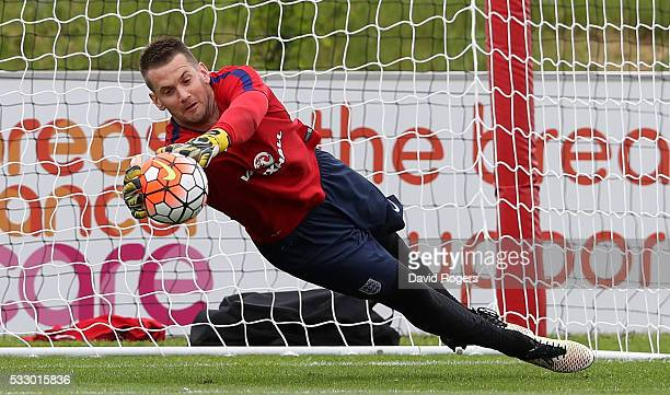 Tom Heaton the England goalkeeper saves during the England training session at St Georges Park on May 20 2016 in BurtonuponTrent England